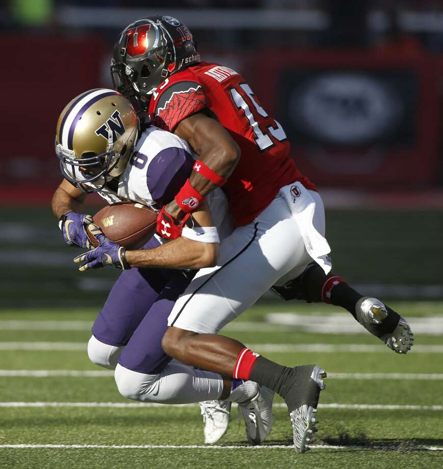 Dante Pettis #8 of the Washington Huskies is tackled after catching a pass by Dominique Hatfield #15 of the Utah Utes during the second half at Rice-Eccles Stadium on October 29, 2016 in Salt Lake City, Utah. Washington defeated Utah 31-24. (Photo by George Frey/Getty Images) Photo: George Frey/Getty Images