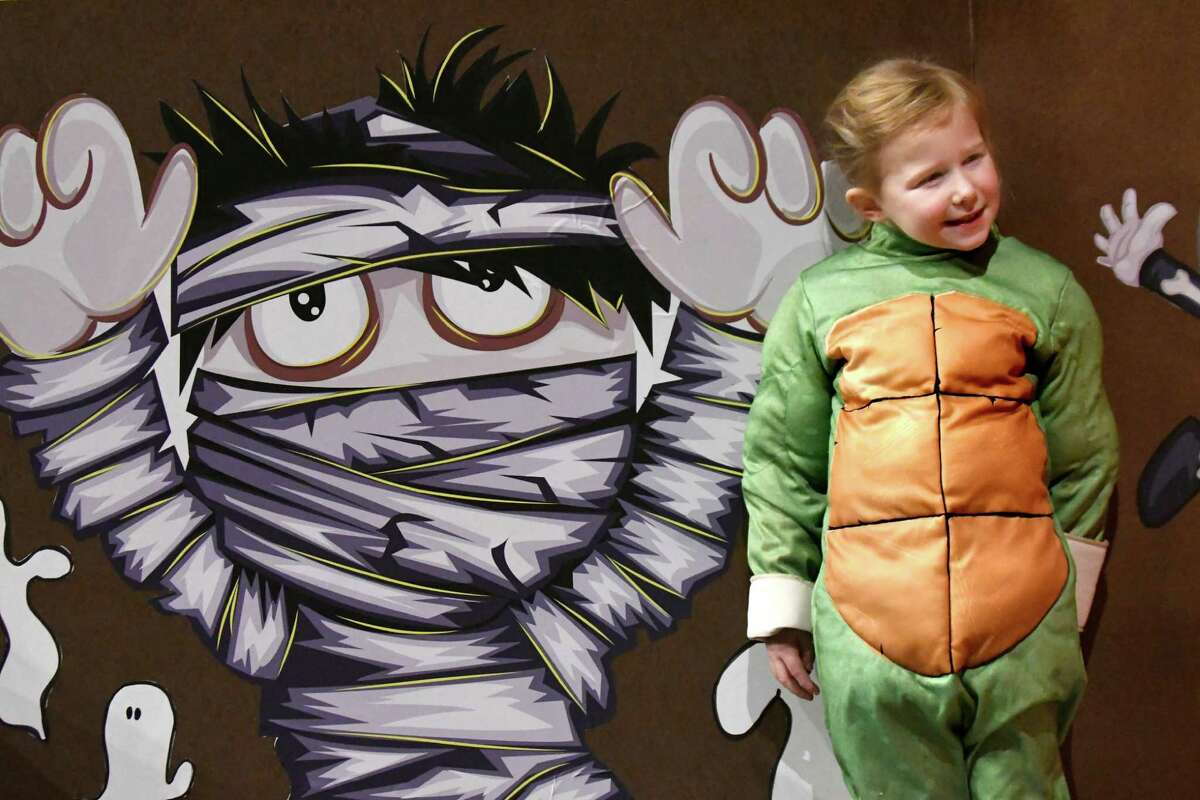 Esme Woodard, 5, of Voorheesville, dressed as Leonardo of the Teenage Mutant Ninja Turtles, poses for a picture during the Monster Mash and Bash on Saturday, Oct. 29, 2016, at the State Museum in Albany, N.Y. The event featured games, crafts, face painting and dancing. (Cindy Schultz / Times Union)
