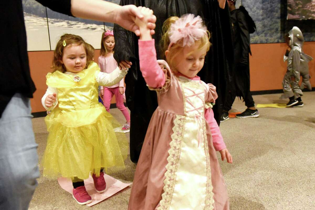 Princesses Sophia Crawford, 2, of Cairo, left, and Gracie Mazzone, 2, of Nassau take part in Musical Squares during the Monster Mash and Bash on Saturday, Oct. 29, 2016, at the State Museum in Albany, N.Y. The event featured games, crafts, face painting and dancing. (Cindy Schultz / Times Union)