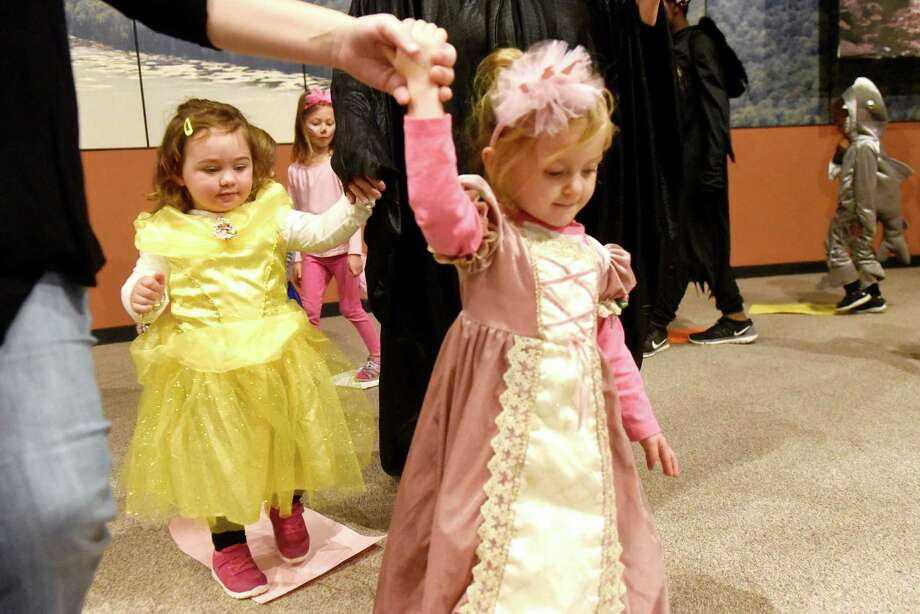 Princesses Sophia Crawford, 2, of Cairo, left, and Gracie Mazzone, 2, of Nassau take part in Musical Squares during the Monster Mash and Bash on Saturday, Oct. 29, 2016, at the State Museum in Albany, N.Y. The event featured games, crafts, face painting and dancing. (Cindy Schultz / Times Union) Photo: Cindy Schultz / Albany Times Union