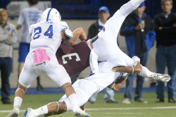 Lee's Grant Brown (3) flips in the air while being tackled by Wolfforth Frenship's Adryane Atkins and Scooter Garcia (24) on Friday, Oct. 28, 2016, at Grande Communications Stadium. James Durbin/Reporter-Telegram