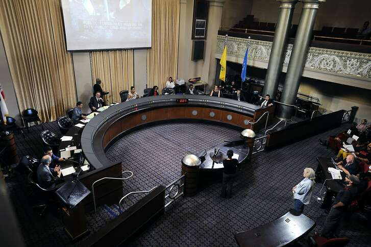 Council members sit at the dais and listen to public comments during an Oakland City Council held at City Hall in Oakland, CA Wednesday, July 7, 2015.