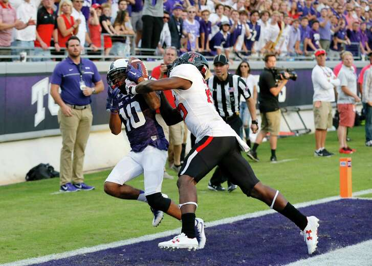 TCU wide receiver Desmon White (10) catches a pass for a touchdown as Texas Tech defensive back Douglas Coleman (25) defends in overtime of an NCAA college football game, Saturday, Oct. 29, 2016, in Fort Worth, Texas. Texas Tech won in double overtime, 27-24. (AP Photo/Tony Gutierrez)