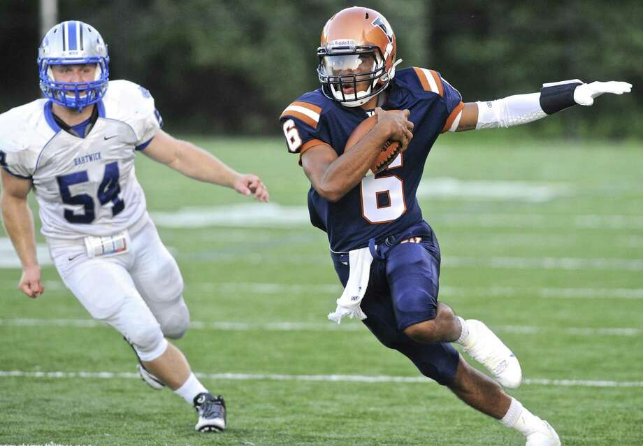 FILE PHOTO: Western's Quinn Fleeting (6) runs around the corner while being pursued by Hartwick's Nate Farley (54) in the Hartwick College at Western Connecticut State University football game on Saturday afternoon, September 3, 2016, at the WCSU Westside Athletic Complex in Danbury, Conn. Photo: H John Voorhees III / Hearst Connecticut Media / The News-Times