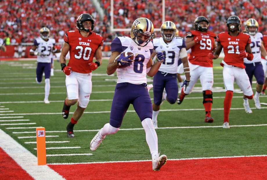 Washington punt returner Dante Pettis (8) scores a touchdown against Utah in the second half of an NCAA college football game, Saturday, Oct. 29, 2016, in Salt Lake City. Washington won 31-24. (AP Photo/Rick Bowmer) Photo: Rick Bowmer, STF / Copyright 2016 The Associated Press. All rights reserved.
