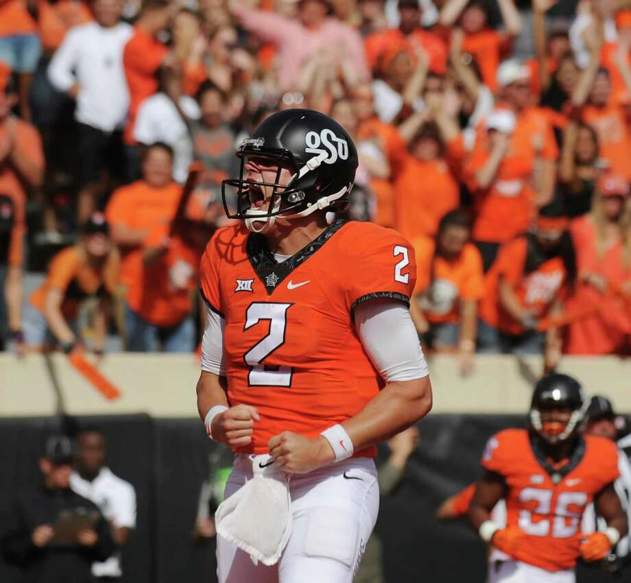 Oklahoma State quarterback Mason Rudolph passed for three touchdowns and ran for another during an upset of No. 10 West Virginia on Saturday. Photo: Brody Schmidt, FRE / FR79308 AP