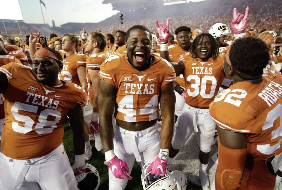 University of Texas players celebrate their victory over eighth-ranked Baylor on Saturday in Austin. The Longhorns improved to 4-4 and 2-3 in the Big 12 with the victory that came on a last-minute field goal. Photo: Eric Gay, STF / Copyright 2016 The Associated Press. All rights reserved.