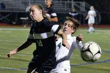 Bethlehem's #14 Grace Hotaling, left,  Shen's #4 Ava Sullivan collide as they chase the ball in overtime during their Class AA girls' soccer semifinals Saturday Oct. 29, 2016 in Stillwater, NY.  (John Carl D'Annibale / Times Union)