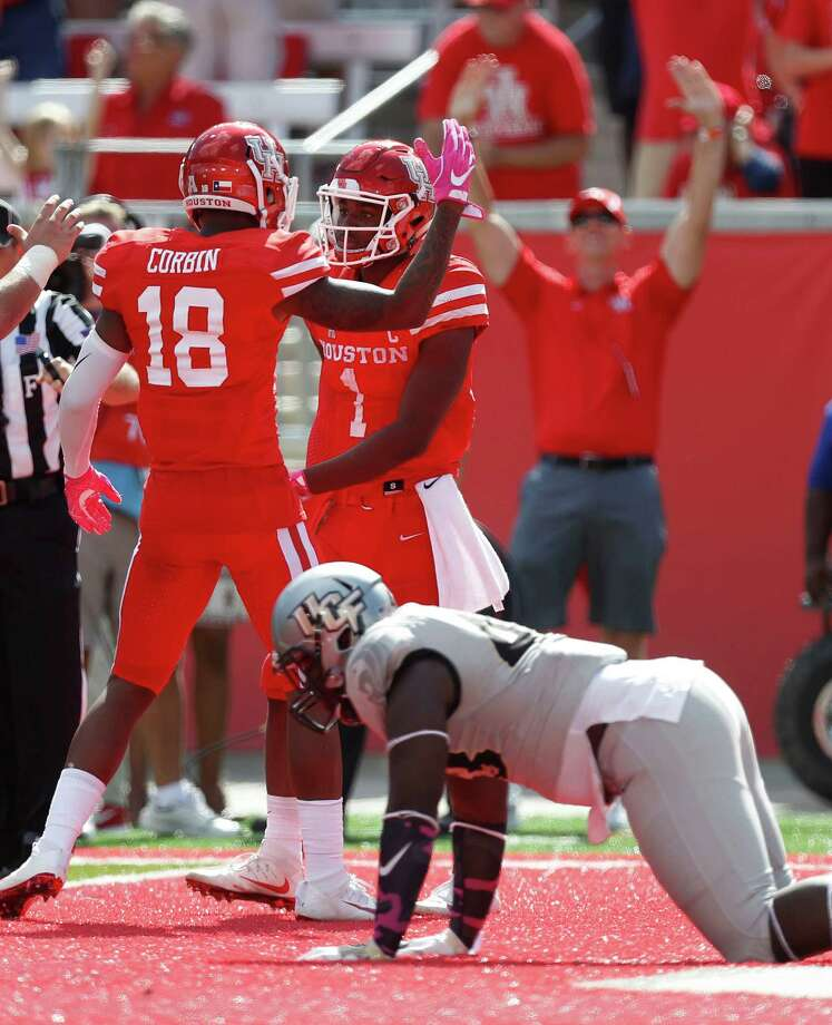 UH quarterback Greg Ward Jr. (1) celebrates with wide receiver Keith Corbin after scoring the go-ahead touchdown on 14-yard run in the fourth quarter Saturday at TDECU Stadium. Photo: Karen Warren, Staff Photographer / 2016 Houston Chronicle