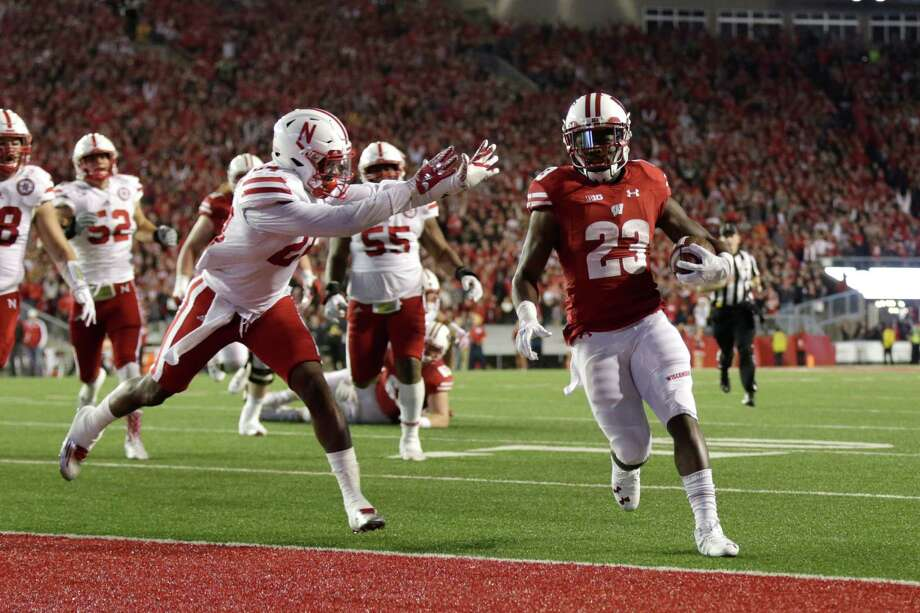 Dare Ogunbowale (23) of Wisconsin Badgers runs for a touchdown in overtime against Nebraska Saturday. Photo: Mike McGinnis, Stringer / 2016 Getty Images