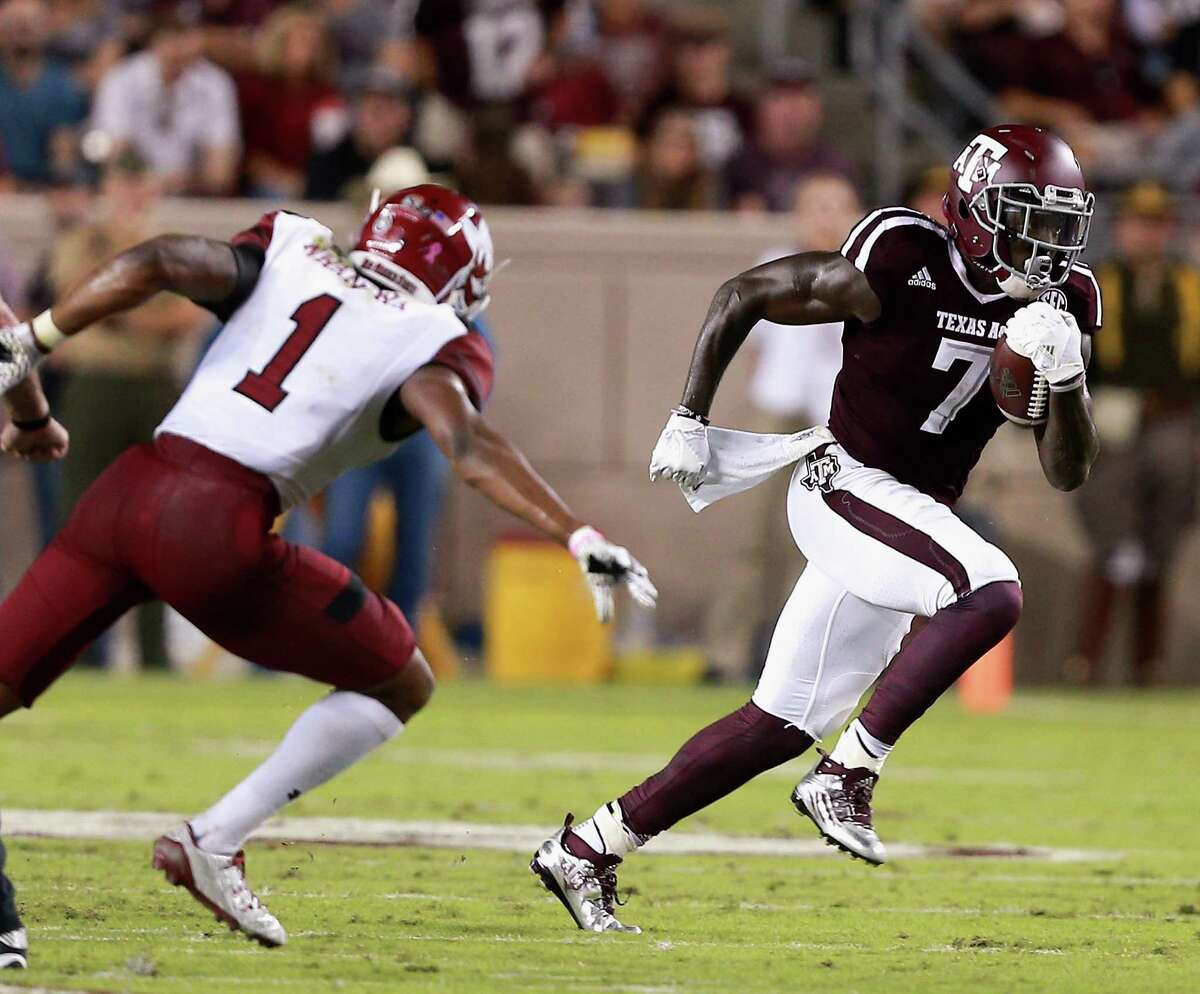 COLLEGE STATION, TX - OCTOBER 29: Keith Ford #7 of the Texas A&M Aggies rushes past Jacob Nwangwa #1 of the New Mexico State Aggies at Kyle Field on October 29, 2016 in College Station, Texas.