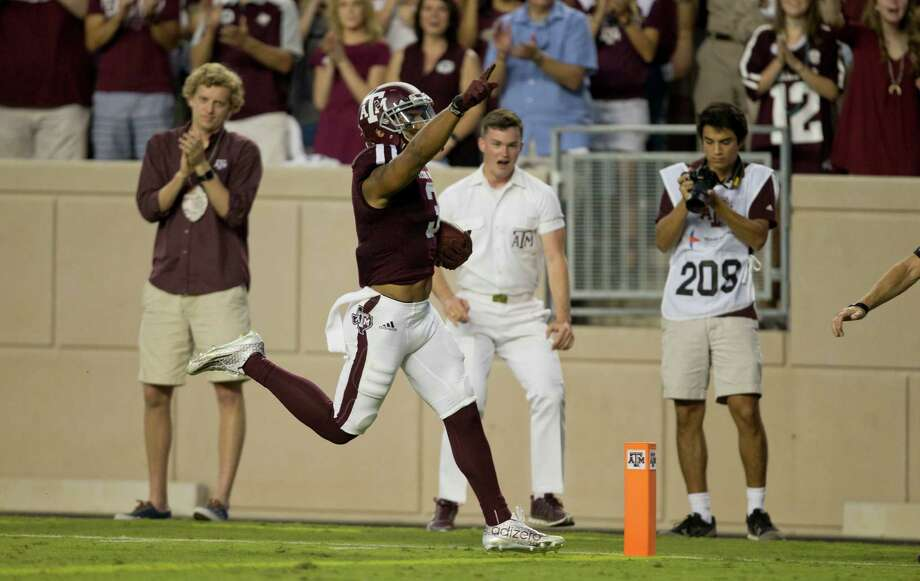 Texas A&M's Christian Kirk crosses the goal line to cap a 73-yard punt return. He also returned another punt 70 yards for a touchdown against New Mexico State. Photo: Sam Craft, FRE / AP