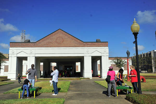 """Families make their way through the outdoor activities during the Art Museum of Southeast Texas' annual """"Eat-A-Bug"""" free family arts day. The popular event offers fried crickets, a Halloween costume contest, arts and crafts, including making Day of the Dead sugar skulls, face painting and snacks.  Photo taken Saturday, October 29, 2016 Kim Brent/The Enterprise"""