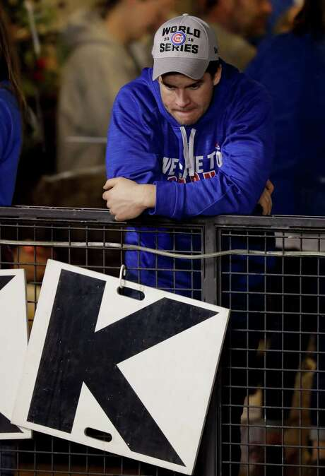 A dejected Chicago Cubs fan watches during the during the ninth inning of Game 4 of the Major League Baseball World Series against the Cleveland Indians Saturday, Oct. 29, 2016, in Chicago. (AP Photo/Charles Rex Arbogast) Photo: Charles Rex Arbogast, Associated Press / Copyright 2016 The Associated Press. All rights reserved.