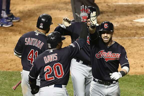 CHICAGO, IL - OCTOBER 29:  Rajai Davis #20, Carlos Santana #41, and Coco Crisp #4 of the Cleveland Indians congratulate Jason Kipnis #22 after Kipnis hit a home run in the seventh inning against the Chicago Cubs in Game Four of the 2016 World Series at Wrigley Field on October 29, 2016 in Chicago, Illinois.  (Photo by Elsa/Getty Images)