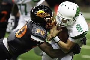 UTSA's Eric Banks tackles North Texas' Darius Turner during the game between the UTSA Roadrunners and the North Texas Mean Green at the Alamodome in San Antonio, Texas on Saturday, October 29, 2016. UTSA defeated North Texas 31-17.