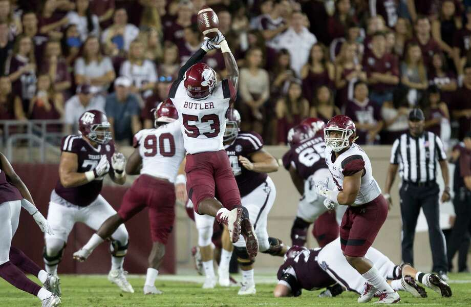 New Mexico State's Rodney Butler (53) bobbles a possible interception against Texas A&M during the first quarter of an NCAA college football game Saturday, Oct. 29, 2016, in College Station, Texas. (AP Photo/Sam Craft) Photo: Sam Craft, Associated Press / AP