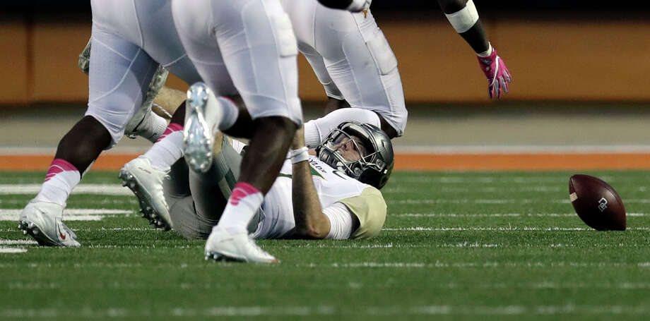 Baylor quarterback Seth Russell (17) falls to the turf after he was hit by Texas linebacker Malik Jefferson (46) as he tired to pass during the final seconds of the second half on a NCAA college football game, Saturday, Oct. 29, 2016, in Austin, Texas. Texas won 35-34. (AP Photo/Eric Gay) Photo: Eric Gay, Associated Press / Copyright 2016 The Associated Press. All rights reserved.