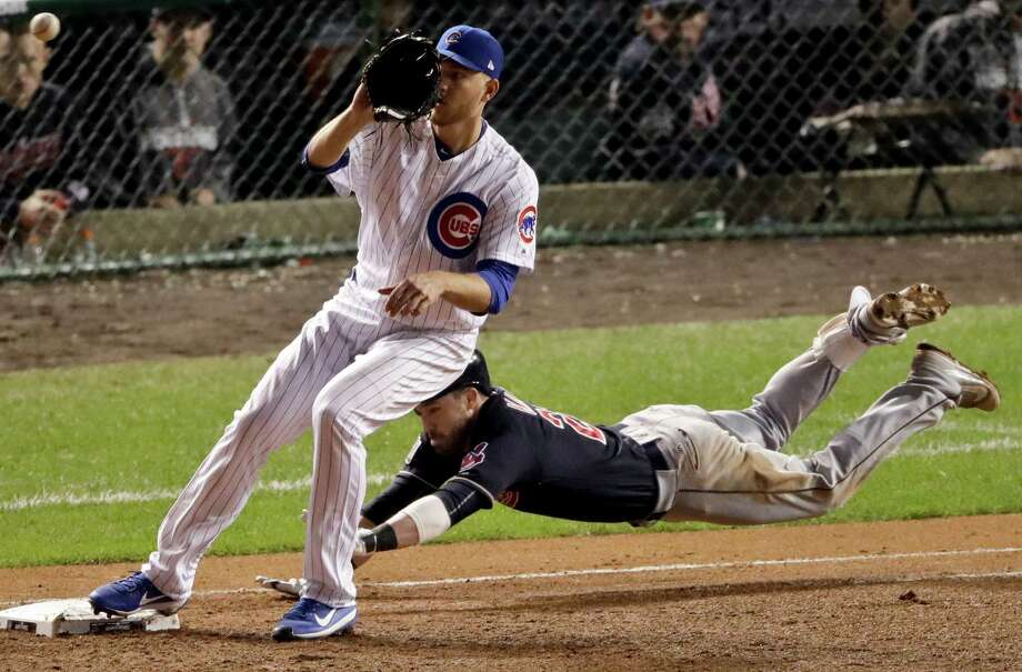 Cleveland Indians' Jason Kipnis is forced out aft first by Chicago Cubs relief pitcher Mike Montgomery during the seventh inning of Game 3 of the Major League Baseball World Series Friday, Oct. 28, 2016, in Chicago. (AP Photo/Charlie Riedel) Photo: Charlie Riedel, STF / Copyright 2016 The Associated Press. All rights reserved.