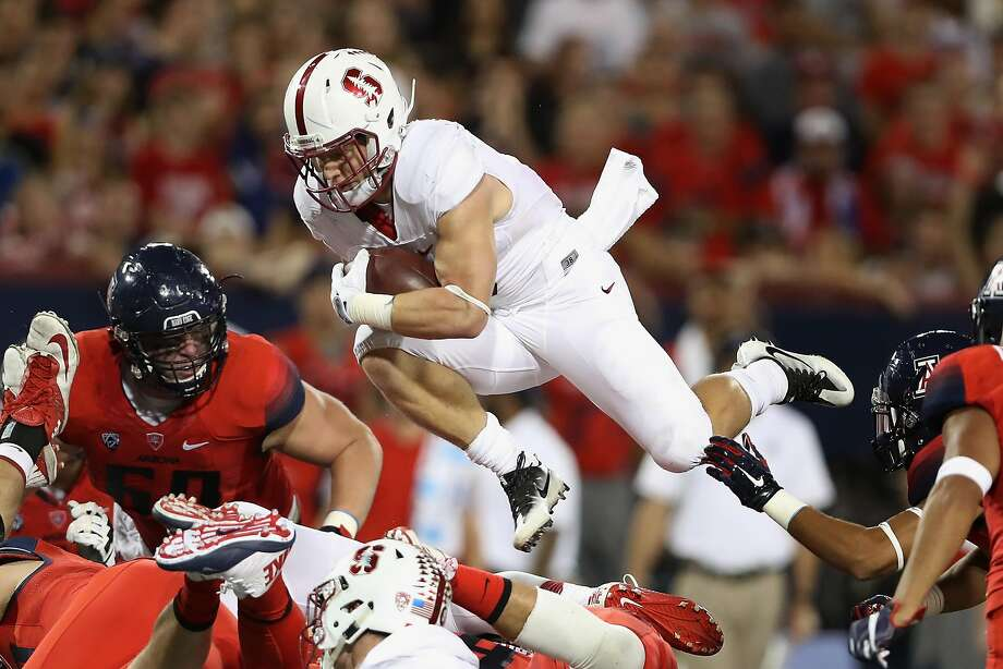 Running back Christian McCaffrey of the Stanford Cardinal leaps with the football as he rushes against the Arizona Wildcats during the second quarter of the college football game at Arizona Stadium on Oct. 29, 2016, in Tucson, Arizona. Photo: Christian Petersen, Getty Images