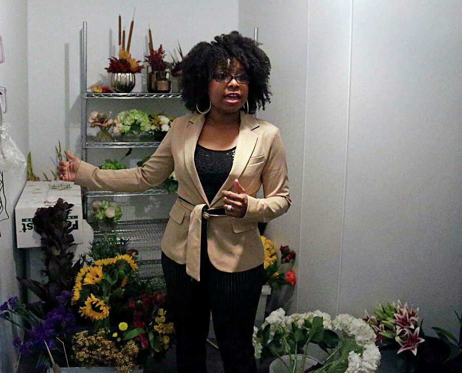 KC Events & Florals'  Sherronda Scoggins shows off the company's walk in cooler Oct. 21, 2016, in Houston. Photo: James Nielsen, Houston Chronicle / © 2016  Houston Chronicle