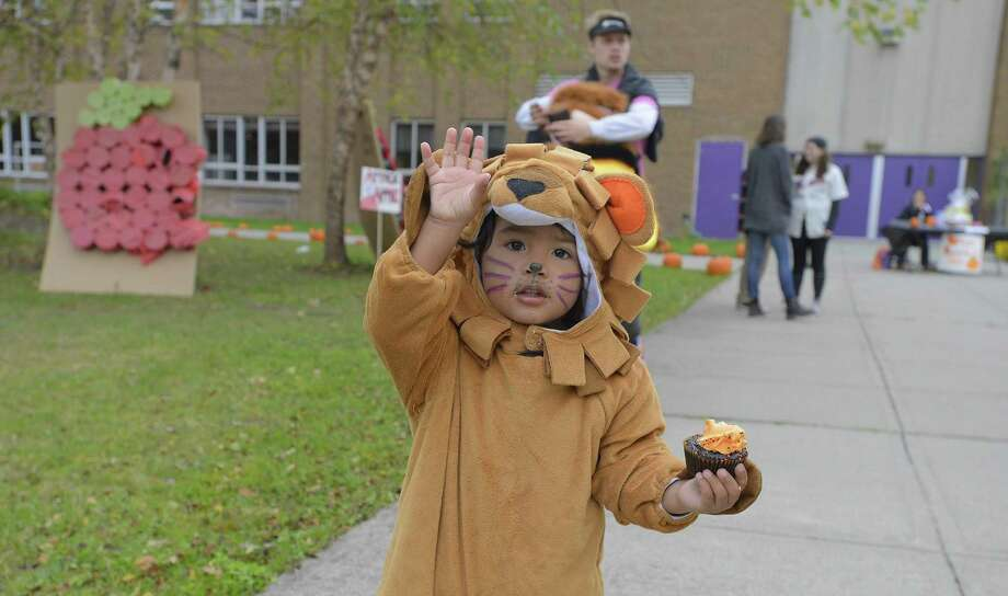 Phillip Requena, 2, of Stamford waves as he visits the AGRI Science Haunted House and Fall Festival at Westhill High School in Stamford on Saturday, Oct. 29, 2016. Over 100 students from the AGRI Science program transformed the schools agricultural center in to a haunted house and set up fun stations outside for young children to enjoy painting a pumpkins, face painting, smashing apples for prizes. Proceeds from the event will help fund student scholarships, that gathers students from surrounding Stamford communities. Photo: Matthew Brown / Hearst Connecticut Media / Stamford Advocate