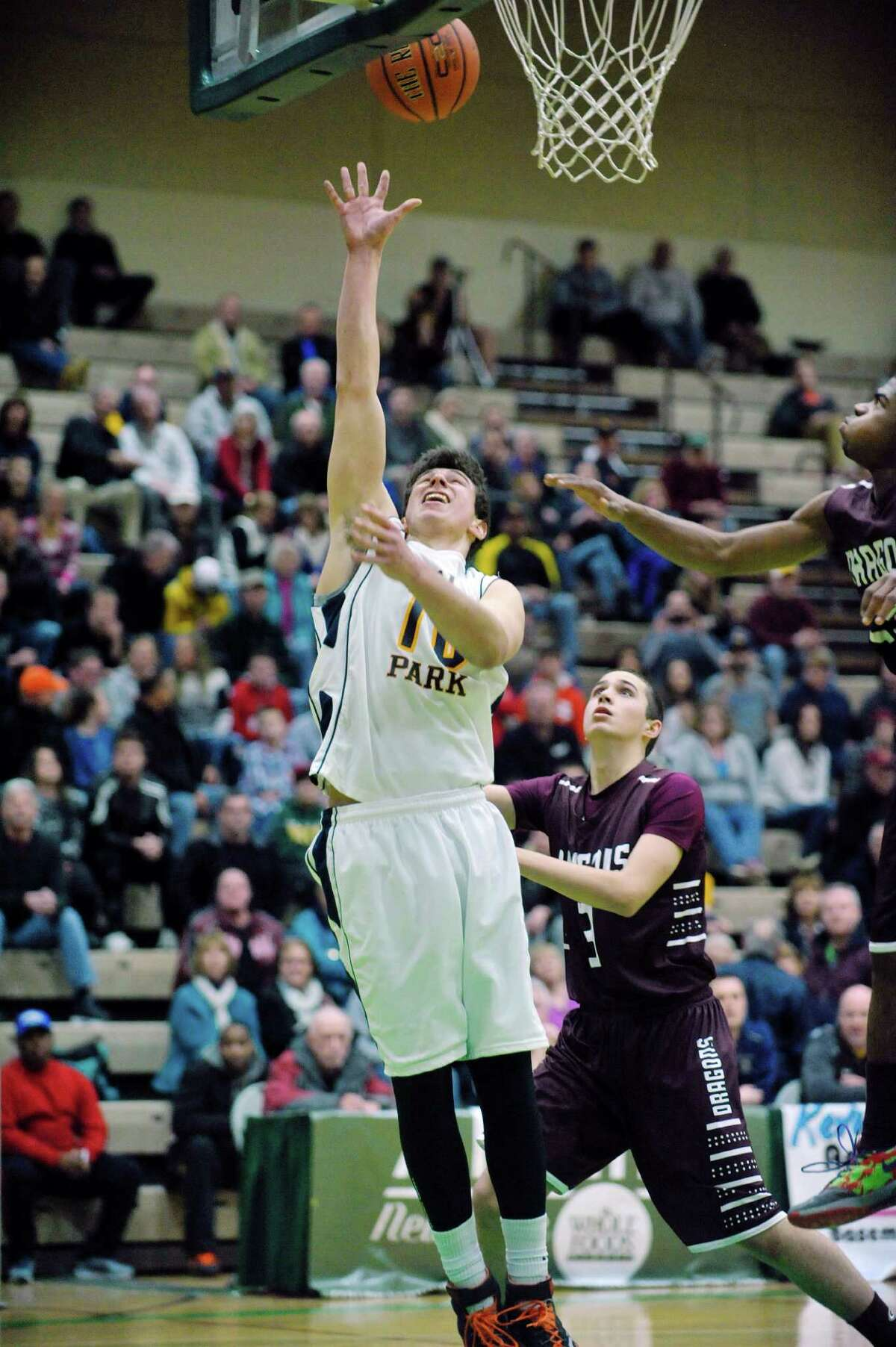 Ryan Bielawa of Averill Park puts up a shot between Gloversville players during their Class A quarterfinal game at Hudson Valley Community College on Sunday, March 1, 2015, in Troy, N.Y. (Paul Buckowski / Times Union)