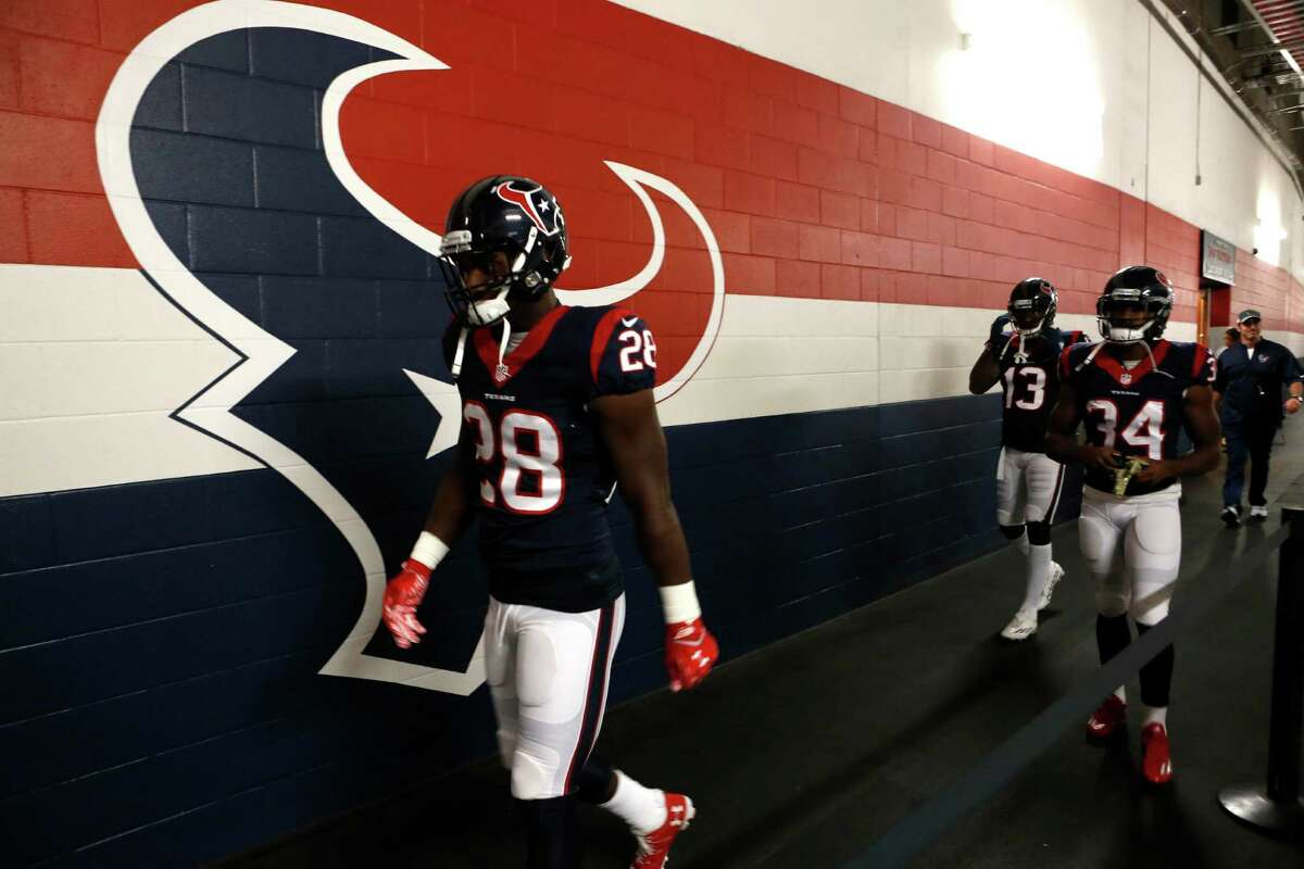 Houston Texans running back Alfred Blue (28), Tyler Ervin (34) and wide receiver Braxton Miller (13) walk to the field before an NFL football game against the Detroit Lions at NRG Stadium on Sunday, Oct. 30, 2016, in Houston.