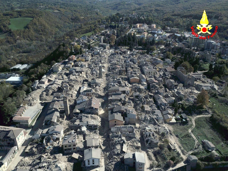 An aerial view of the destroyed hilltop town of Amatrice as an earthquake with a preliminary magnitude of 6.6 struck central Italy, Sunday, Oct. 30, 2016. A powerful earthquake rocked the same area of central and southern Italy hit by quake in August and a pair of aftershocks last week, sending already quake-damaged buildings crumbling after a week of temblors that have left thousands homeless.  (Vigili Del Fuoco/Italian Firefighters via AP) Photo: AP