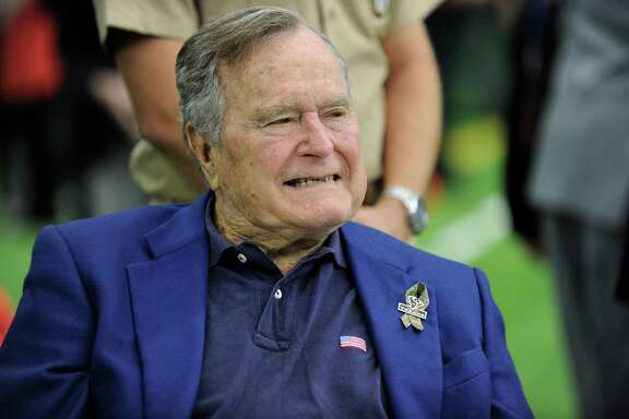 Former President George H.W. Bush arrives at NRG Stadium to help celebrate Salute to Service day before an NFL football game between the Houston Texans and the Detroit Lions, Sunday, Oct. 30, 2016, in Houston. (AP Photo/Eric Christian Smith)