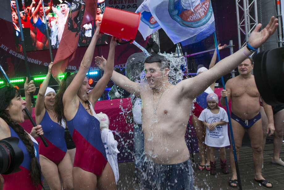 Russian ice swimmers demonstrate their bravery and skills during a student sport parade event in Moscow, Russia, on Saturday, Oct., 29, 2016. The massed sporting parades of the Soviet Union are being revived in Moscow this weekend with a huge parade of student sportsmen and a series of events showing off sporting talent. (AP Photo/Alexander Zemlianichenko Jr.) Photo: Alexander Zemlianichenko Jr/AP