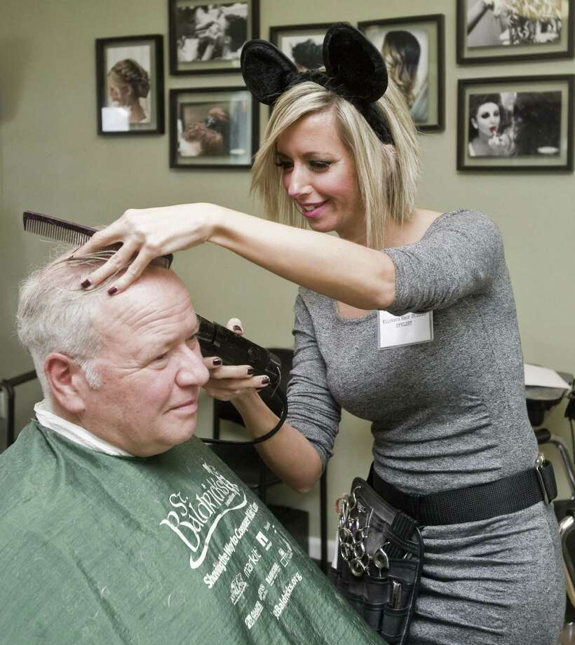 Stylist Lara Saraiva cuts John Borduas' hair during Klickers Hair Studio's benefit cut-a-thon. Photo: Scott Mullin / For Hearst Connecticut Media / The News-Times Freelance