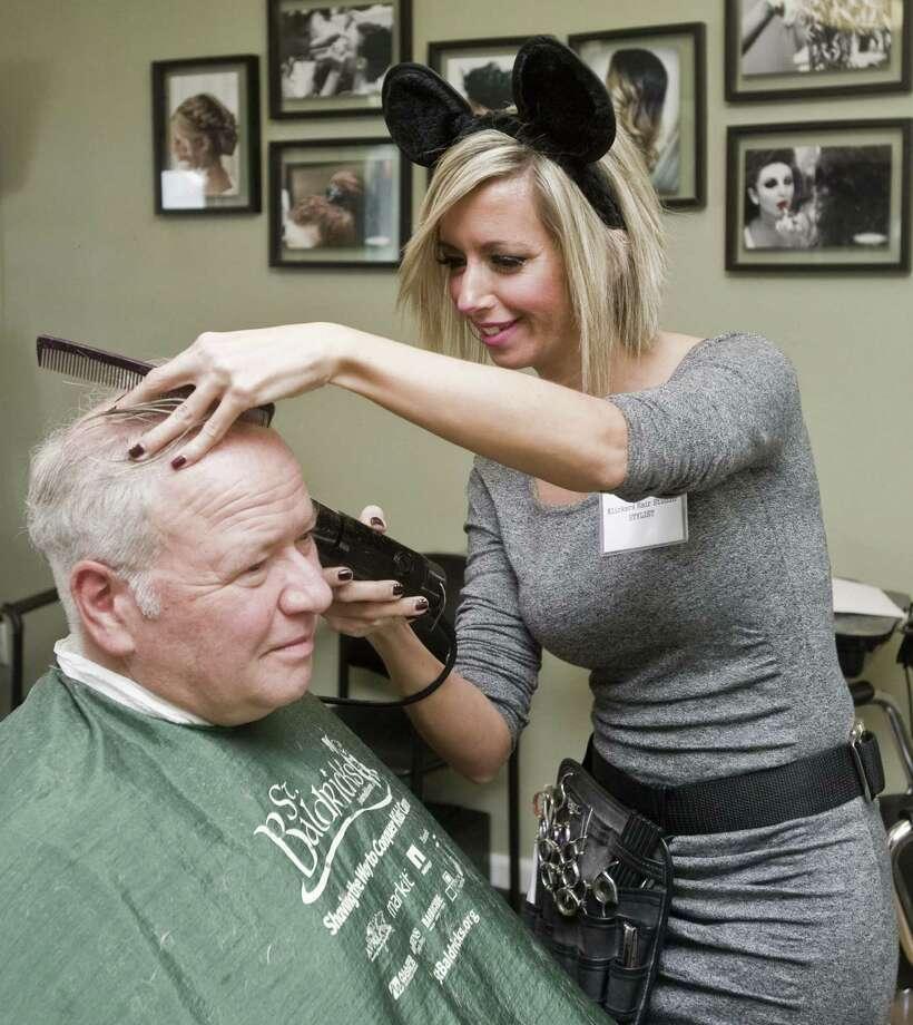 Stylist Lara Saraiva cuts John Borduas' hair during Klickers Hair Studio's benefit cut-a-thon. Photo: Scott Mullin / For Hearst Connecticut Media / The News-Times Freelance