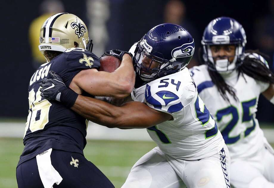Seattle Seahawks linebacker Bobby Wagner (54) tries to tackle New Orleans Saints running back Daniel Lasco (36) in the first half of an NFL football game in New Orleans, Sunday, Oct. 30, 2016. (AP Photo/Butch Dill) Photo: Butch Dill/AP