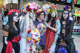 San Antonians celebrated Día de Muertos early this year at La Villita at a free weekend event that included live music, art, dancing, a living altar and a drum and puppet procession.