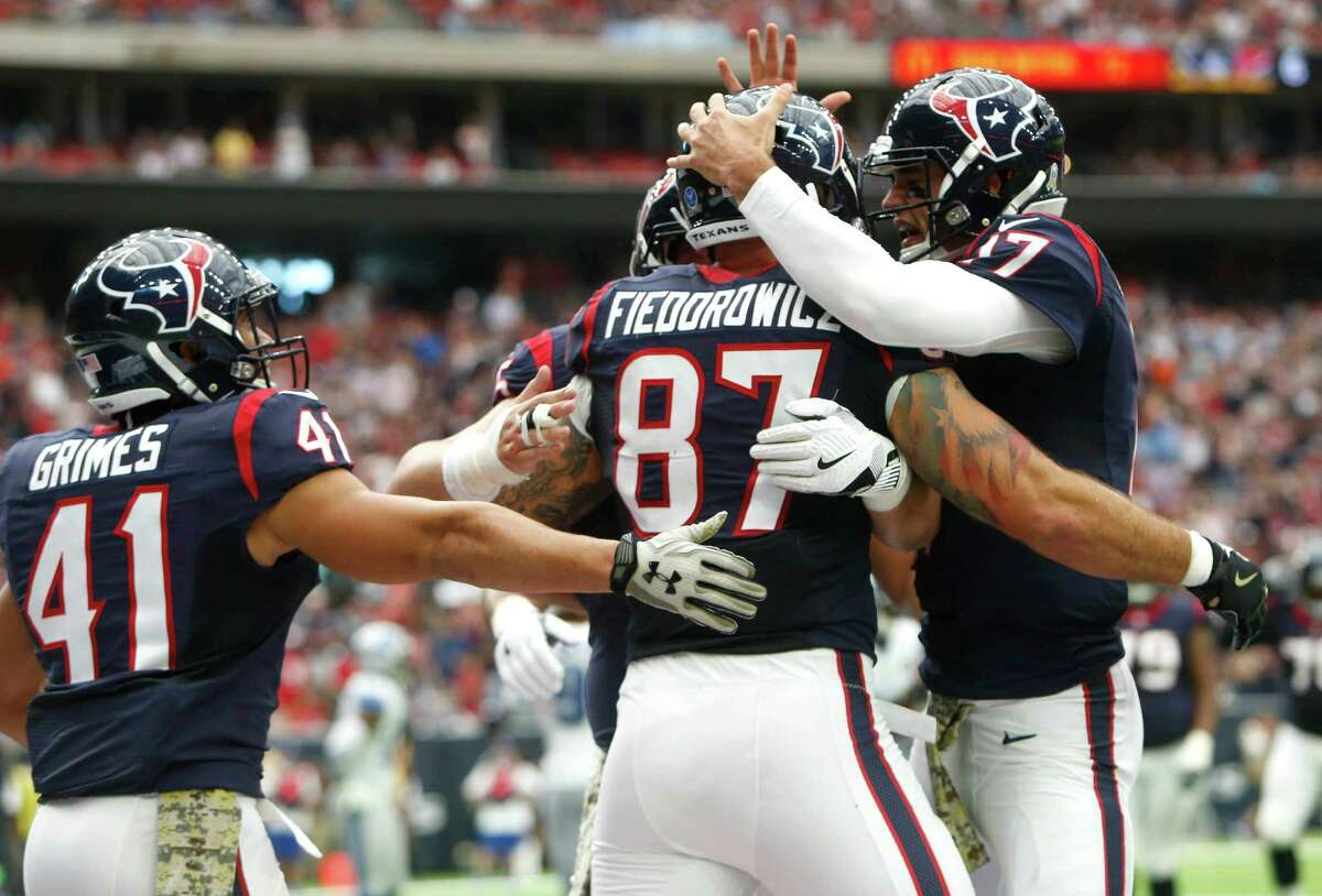 Houston Texans tight end C.J. Fiedorowicz (87) and quarterback Brock Osweiler (17) his 6-yard touchdown reception against the Detroit Lions during the second quarter of an NFL football game at NRG Stadium on Sunday, Oct. 30, 2016, in Houston.