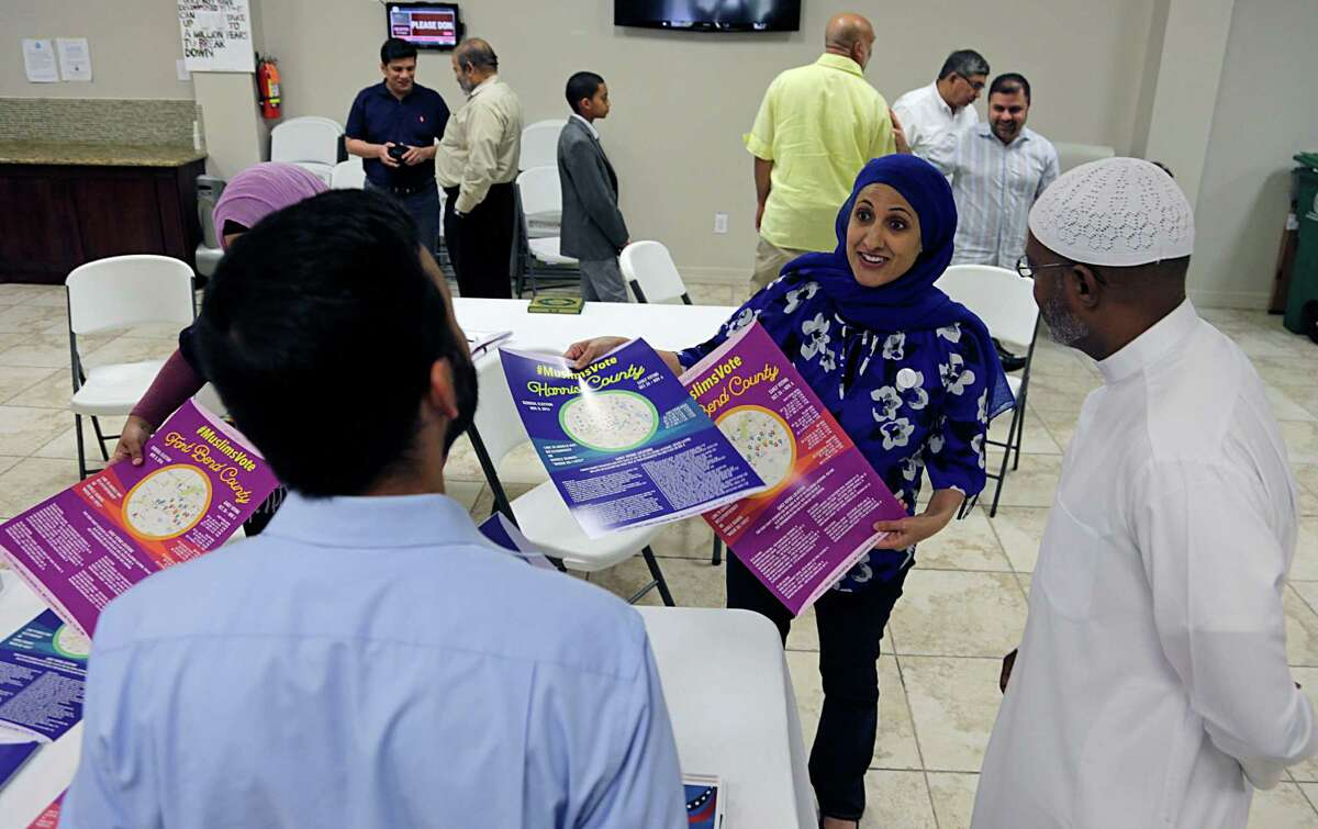 Emerge USA's Nabila Mansoor center, hands out voting information after a prayer service at the Islamic Society of Greater Houston Oct. 21, 2016, in Houston.