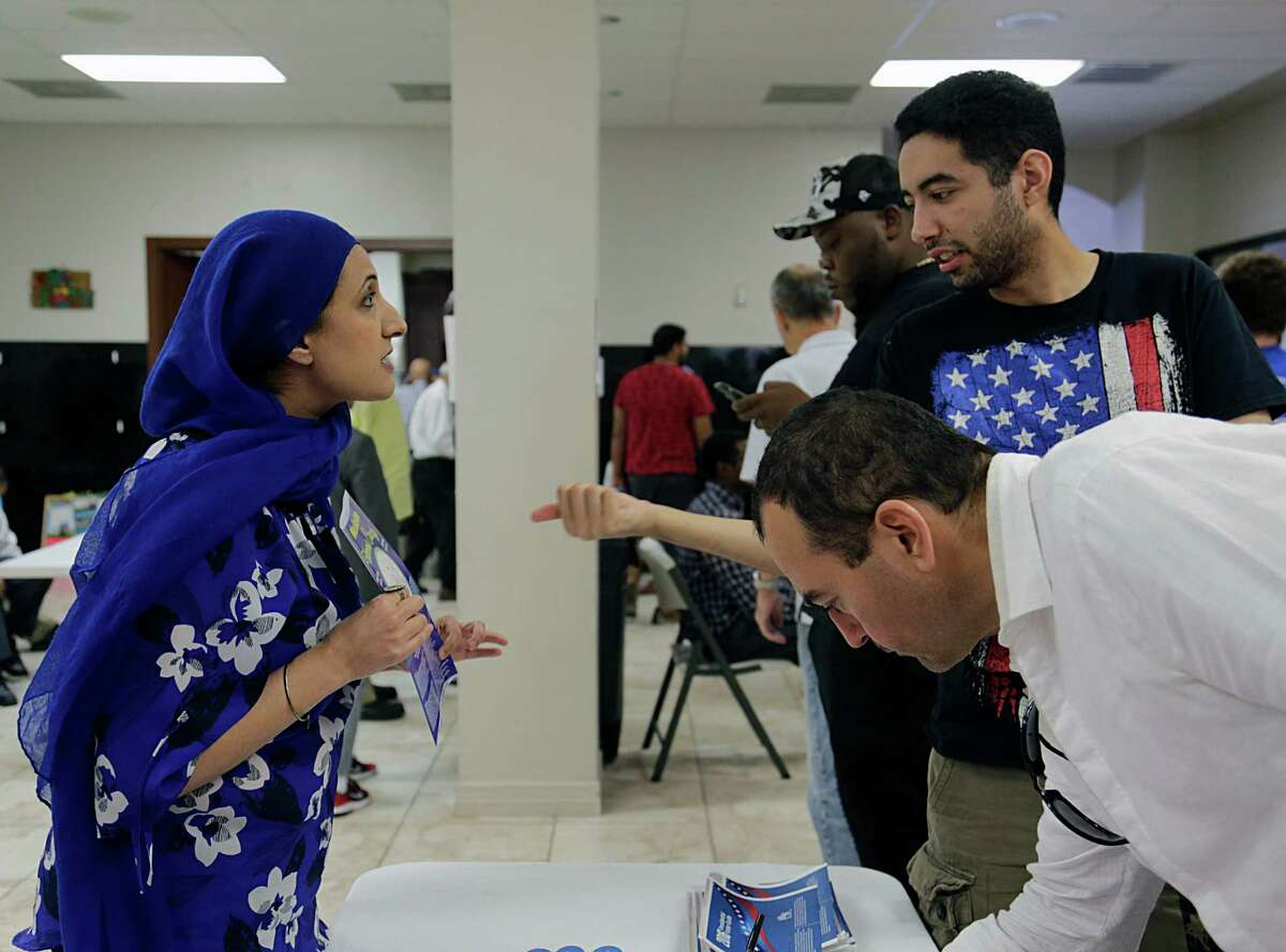 Emerge USA's Nabila Mansoor left, speaks about voting with Muhamad Soliman right, after a prayer service at the Islamic Society of Greater Houston Oct. 21, 2016, in Houston.
