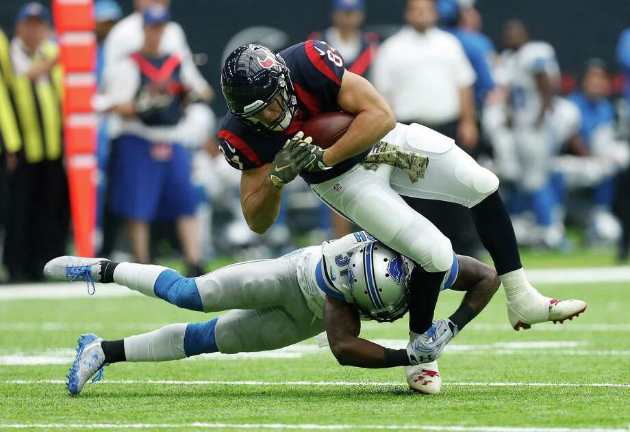 Houston Texans tight end Ryan Griffin (84) gets brought down by Detroit Lions strong safety Rafael Bush (31) during the first quarter an NFL football game at NRG Stadium, Sunday,Oct. 30, 2016 in Houston. Photo: Karen Warren, Houston Chronicle / 2016 Houston Chronicle