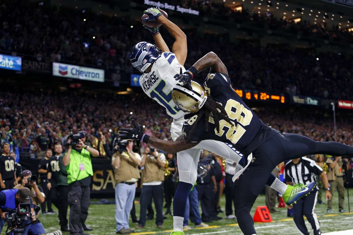 Seattle Seahawks wide receiver Jermaine Kearse (15) leaps for a pass just outside the end zone as New Orleans Saints cornerback B.W. Webb (28) covers as time expires in the second half of an NFL football game in New Orleans, Sunday, Oct. 30, 2016. Kearse came down out of bounds and the Saints won 25-20. (AP Photo/Butch Dill)