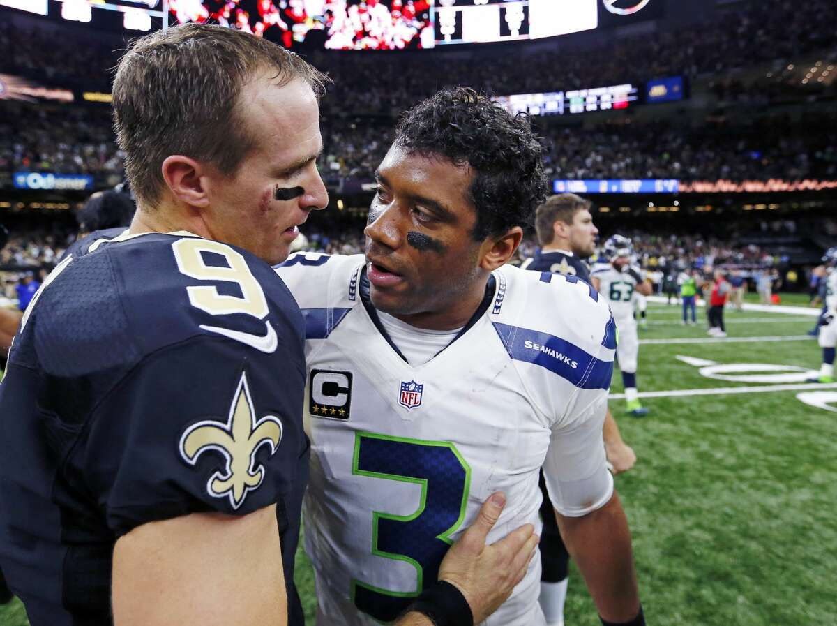 New Orleans Saints quarterback Drew Brees (9) greets Seattle Seahawks quarterback Russell Wilson (3) after an NFL football game in New Orleans, Sunday, Oct. 30, 2016. The Saints won 25-20.(AP Photo/Butch Dill)