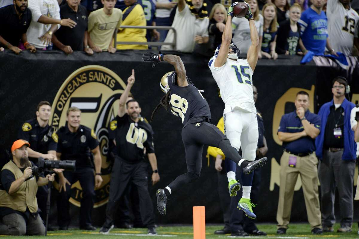 Seattle Seahawks wide receiver Jermaine Kearse (15) leaps for a pass just outside the end zone as New Orleans Saints cornerback B.W. Webb (28) covers as time expires in the second half of an NFL football game in New Orleans, Sunday, Oct. 30, 2016. Kearse came down out of bounds and the Saints won 25-20. (AP Photo/Bill Feig)