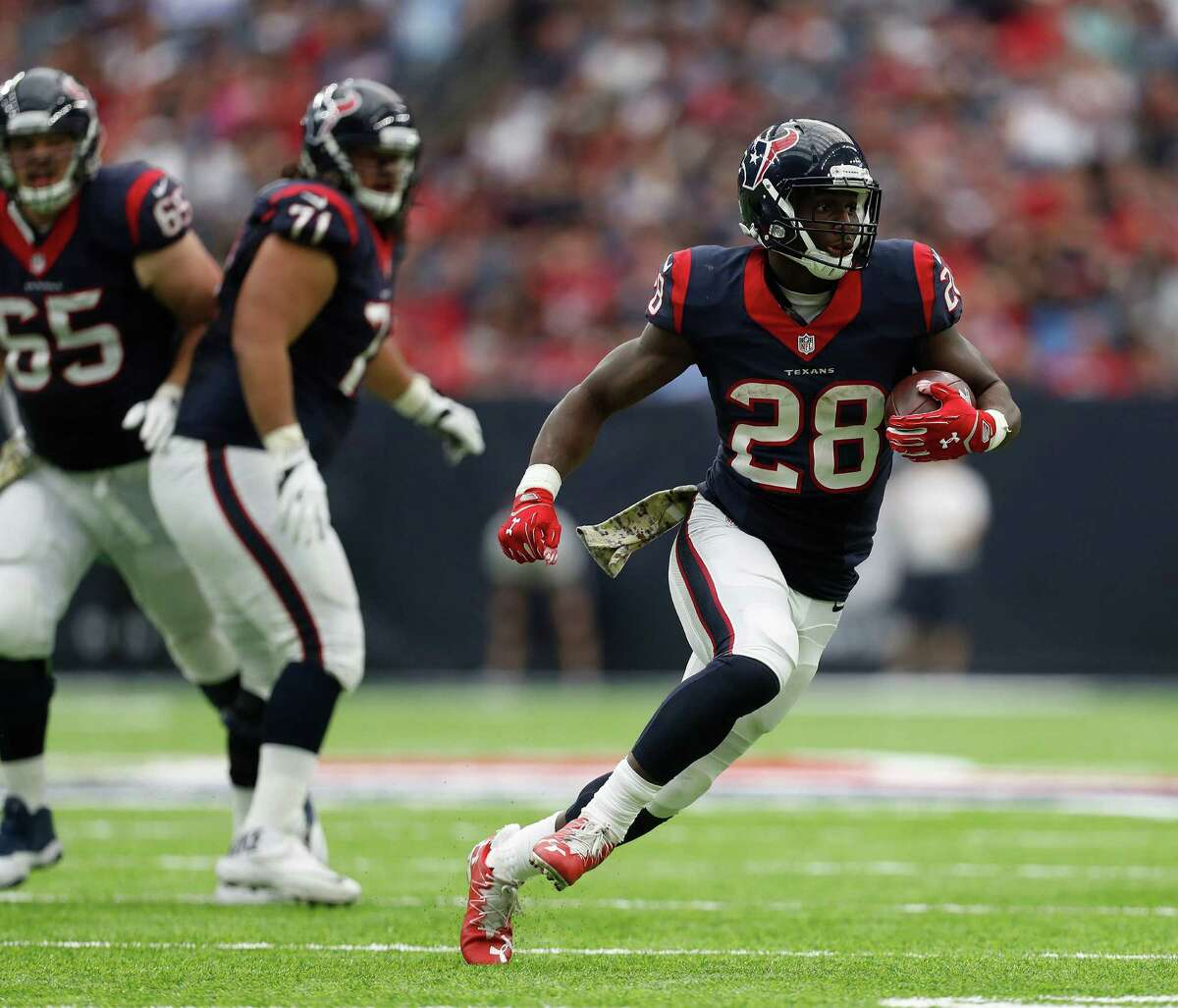 Houston Texans running back Alfred Blue (28) runs the ball for yardage during the fourth quarter an NFL football game at NRG Stadium, Sunday,Oct. 30, 2016 in Houston.
