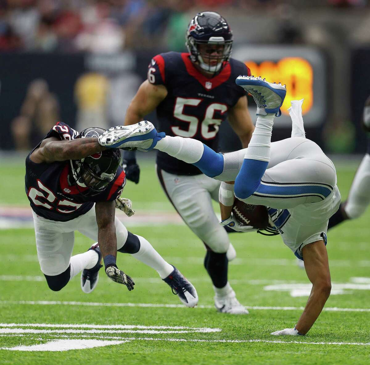 Detroit Lions wide receiver Golden Tate (15) gets upended by Houston Texans cornerback Kareem Jackson (25) during the fourth quarter an NFL football game at NRG Stadium, Sunday,Oct. 30, 2016 in Houston.