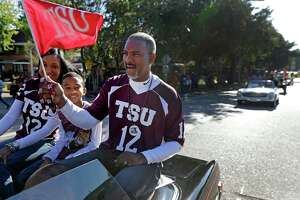 Texas Southern University president Dr. Austin A. Lane, right, his wife, Loren, and son, Lance, 10, ride in the homecoming parade Saturday, Oct. 22, 2016, in Houston.