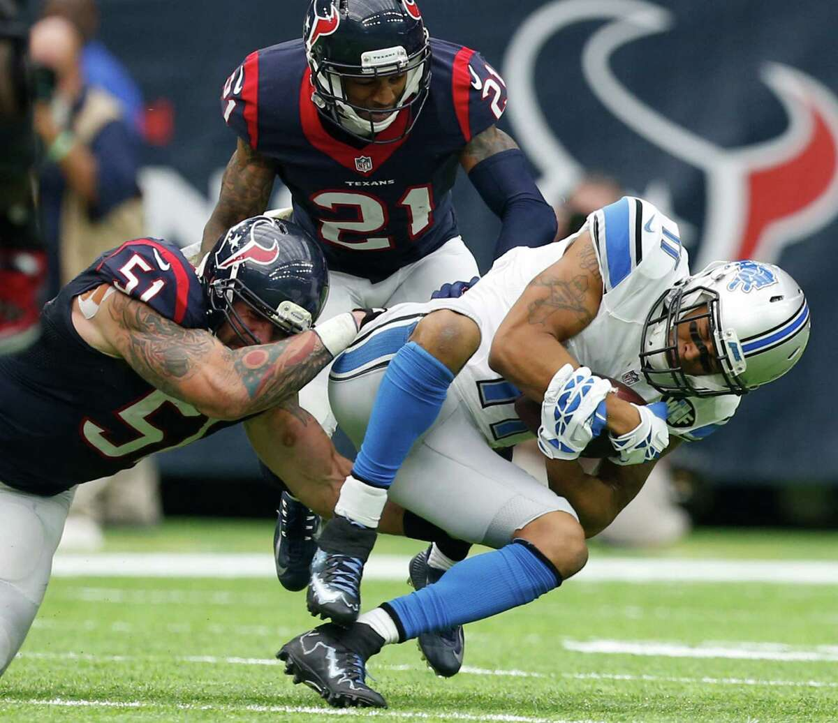 Detroit Lions wide receiver Marvin Jones (11) is stopped by Houston Texans outside linebacker John Simon (51) and cornerback A.J. Bouye (21) during the third quarter of an NFL football game at NRG Stadium on Sunday, Oct. 30, 2016, in Houston.