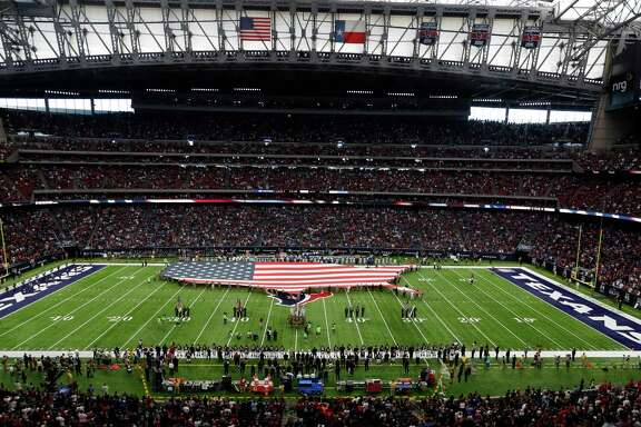 A large American flag made into the shape of the United States on the field before the start of the first quarter an NFL football game at NRG Stadium, Sunday,Oct. 30, 2016 in Houston.