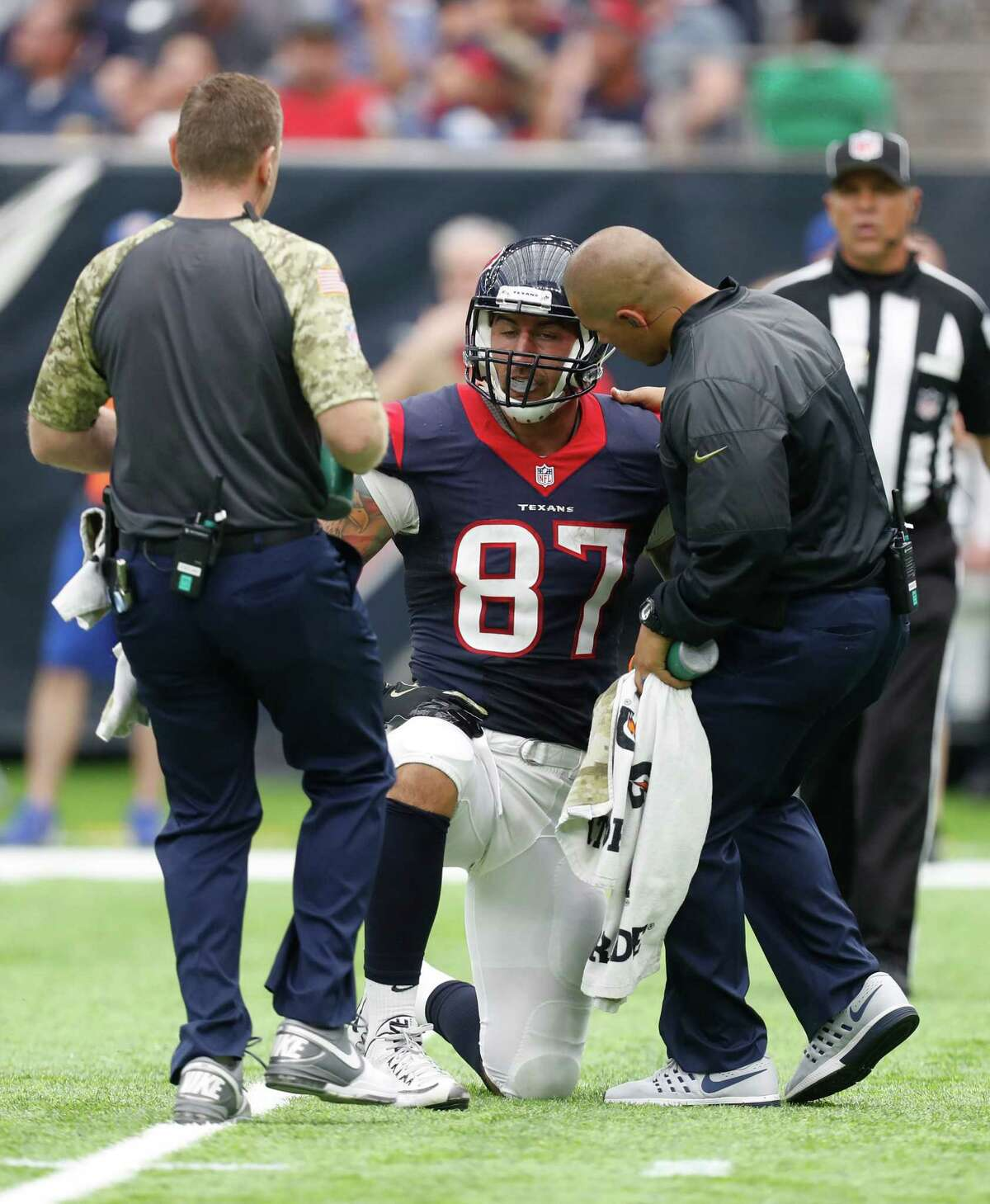 Houston Texans tight end C.J. Fiedorowicz (87) is tended to on the field after an injury during the second quarter an NFL football game at NRG Stadium, Sunday,Oct. 30, 2016 in Houston.