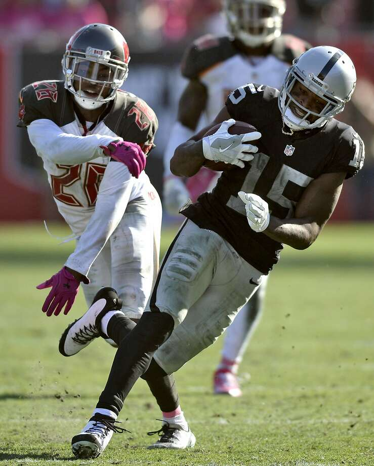 Oakland Raiders wide receiver Michael Crabtree (15) runs past Tampa Bay Buccaneers cornerback Vernon Hargreaves III (28) during the fourth quarter of an NFL football game Sunday, Oct. 30, 2016, in Tampa, Fla. (AP Photo/Jason Behnken) Photo: Jason Behnken, Associated Press