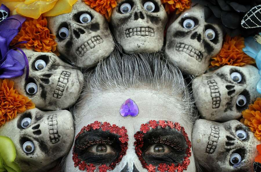 Maricela Flores Dominguez with her skull headdress during the  Unity Council's 21st annual Dia de los Muertos celebration in the Fruitvale district of Oakland, Calif., on Sunday, October 30, 2016. Photo: Carlos Avila Gonzalez, The Chronicle